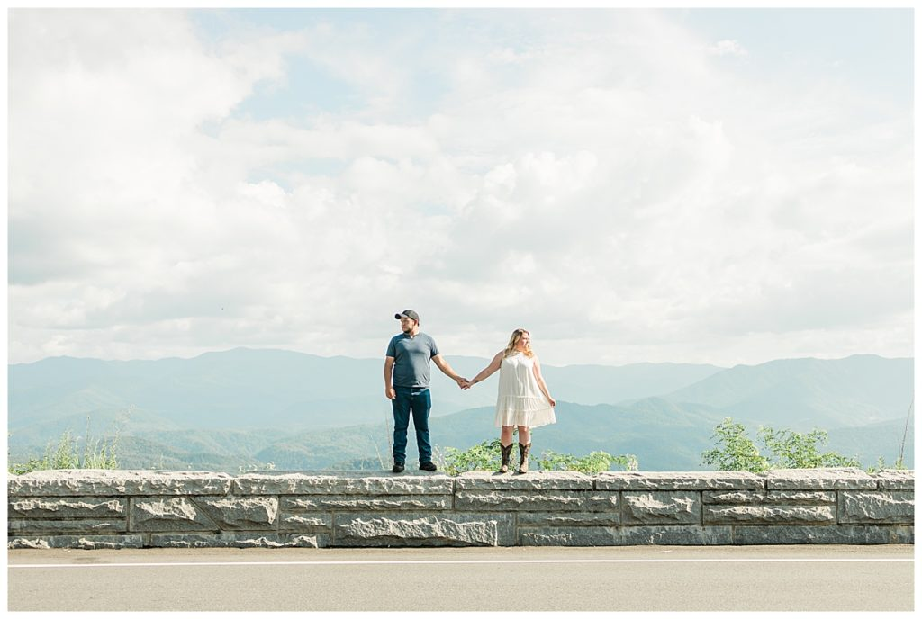 pigeon forge outdoor engagement man and woman standing on wall together